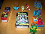 Another Pokémon Cyclone DP dice game, Shinx figure, weird Jolteon figure, Infernape figure, stickers, gum, and keychains. The keychains are called...