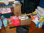 The mess of my room, littered with my niece's stuff, my laptop bag, and my white Alto Sax