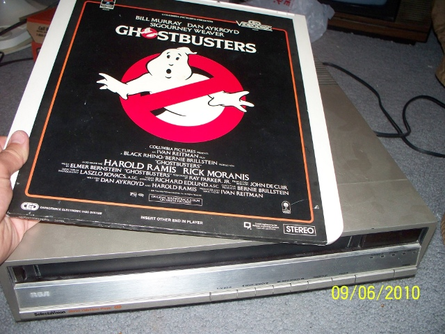 This is the movie Ghostbusters on a CED (Capacitance Electronic Disc) along with the player. Bet you've never seen one of these before.